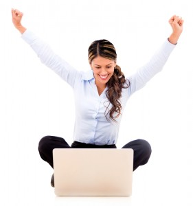 Excited business woman with arms up - isolated over white